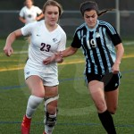 Junior Isabella Velez fights to keep the ball in bounds. Photo by Kate Nixon