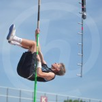 Senior Austin Eckenwiler practices his pole vaulting technique before the first round of boys pole vaulting. Photo by Taylor Keal