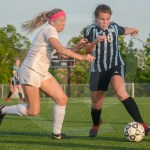 Sophomore Jilli Foley controls the ball on the outskirts of the field. Photo by Elle Karras