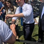 Buttigieg makes his way along the sectioned-off area, shaking hands and discussing with those in attendance. Photo by Ben Henschel.