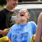 Senior Lily Campbell laughs as she gets cold water squeezed on her. Photo by Annakate Dilks