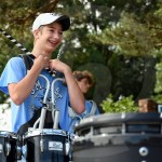 Sophomore Noah Martin smiles while talking to his fellow bandmates in between playing songs. Photo by Annakate Dilks