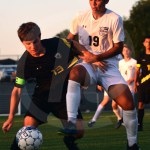 Junior Sean Brooks tries to take the ball back in the lancers possession. Photo by Elle Karras