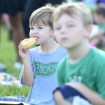 One student at Brookwood enjoys a donut and listens to the South band. Photo by Aislinn Menke.