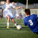 Senior Jack Slaughter stops his track after a through ball gets too close to the goalie of West. Photo by Megan Biles