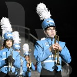 Sophomore Chris Alka stands at attention during the halftime show. Photo by Kate Nixon