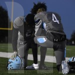 Seniors Jerry Walker and Mkai Jantz pray before the game begins. Photo by Ty Browning