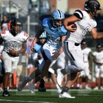 Sophomore Jay Kanova runs in an attempt to tackle northwest's quarterback. Photo by Taylor Keal