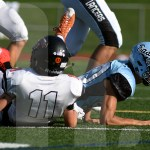 Sophomore Trace Huston tackles the northwest offensive player to prevent him from scoring. Photo by  Taylor Keal