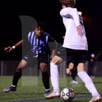 Senior Jodar Marcial defends the goalie from his opponent in the second half. Photo by Elle Karras