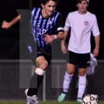 Senior TJ Libeer runs to keep up with the ball when the Lancers were down 1-3. Photo by Elle Karras