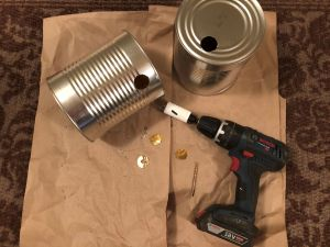 Air intake and exhaust holes drilled on DIY Tin Can Smoker