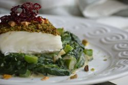 Creamed Spinach with Pistachio Matcha Crusted Halibut on top