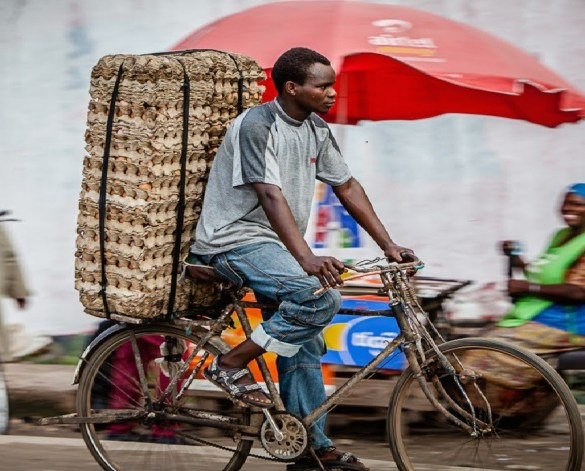 African rural e-commerce - man on wheels picture by Jumia
