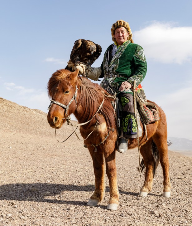 A Kazak Mongolian eagle hunter wearing traditional dress, Bayan Olgii, Mongolia.