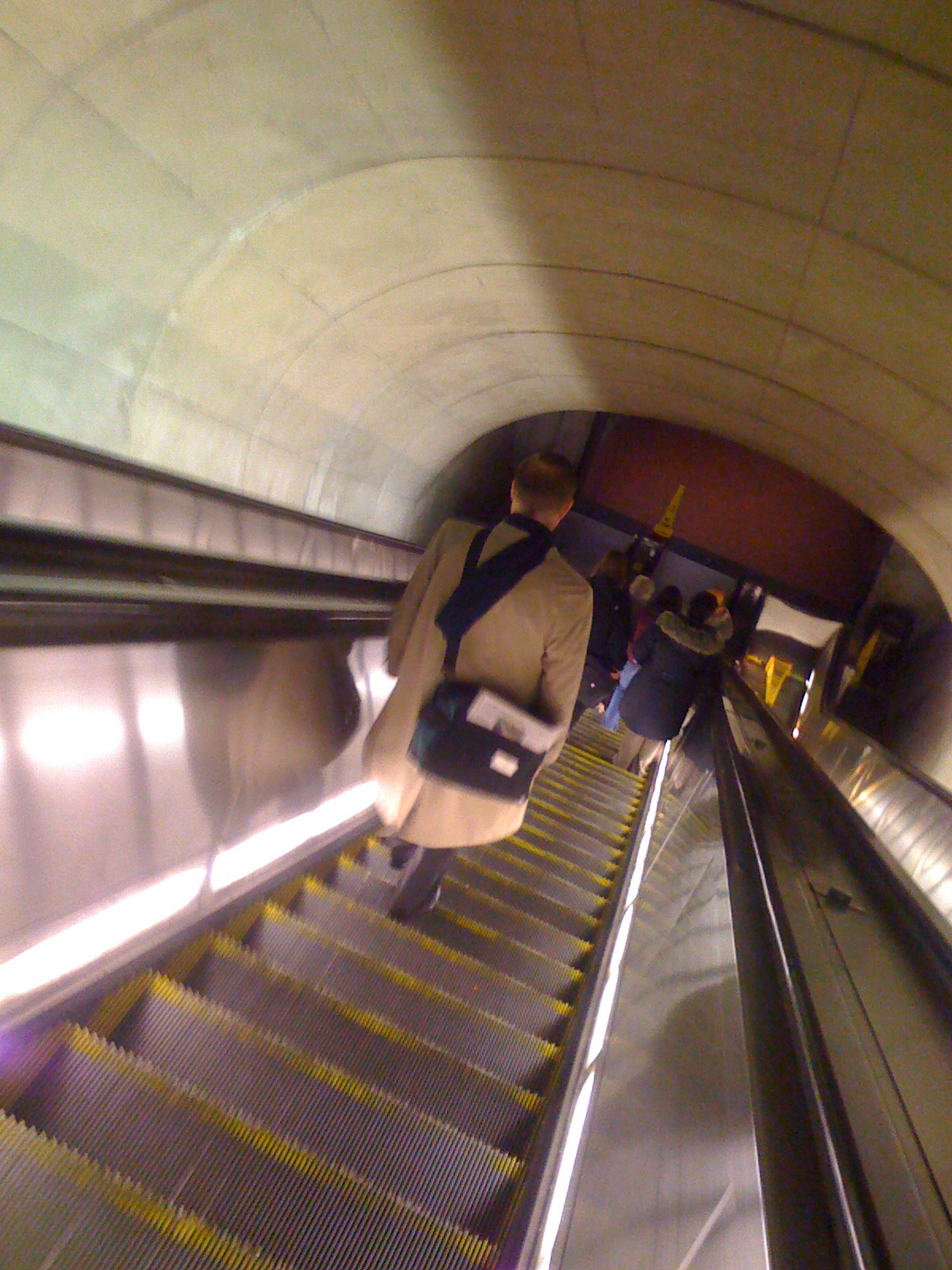 My daily trip down Dupont Circle escalator. The slight blurriness of the photo captures pretty well the touch of vertigo the long Metro escalators give me.