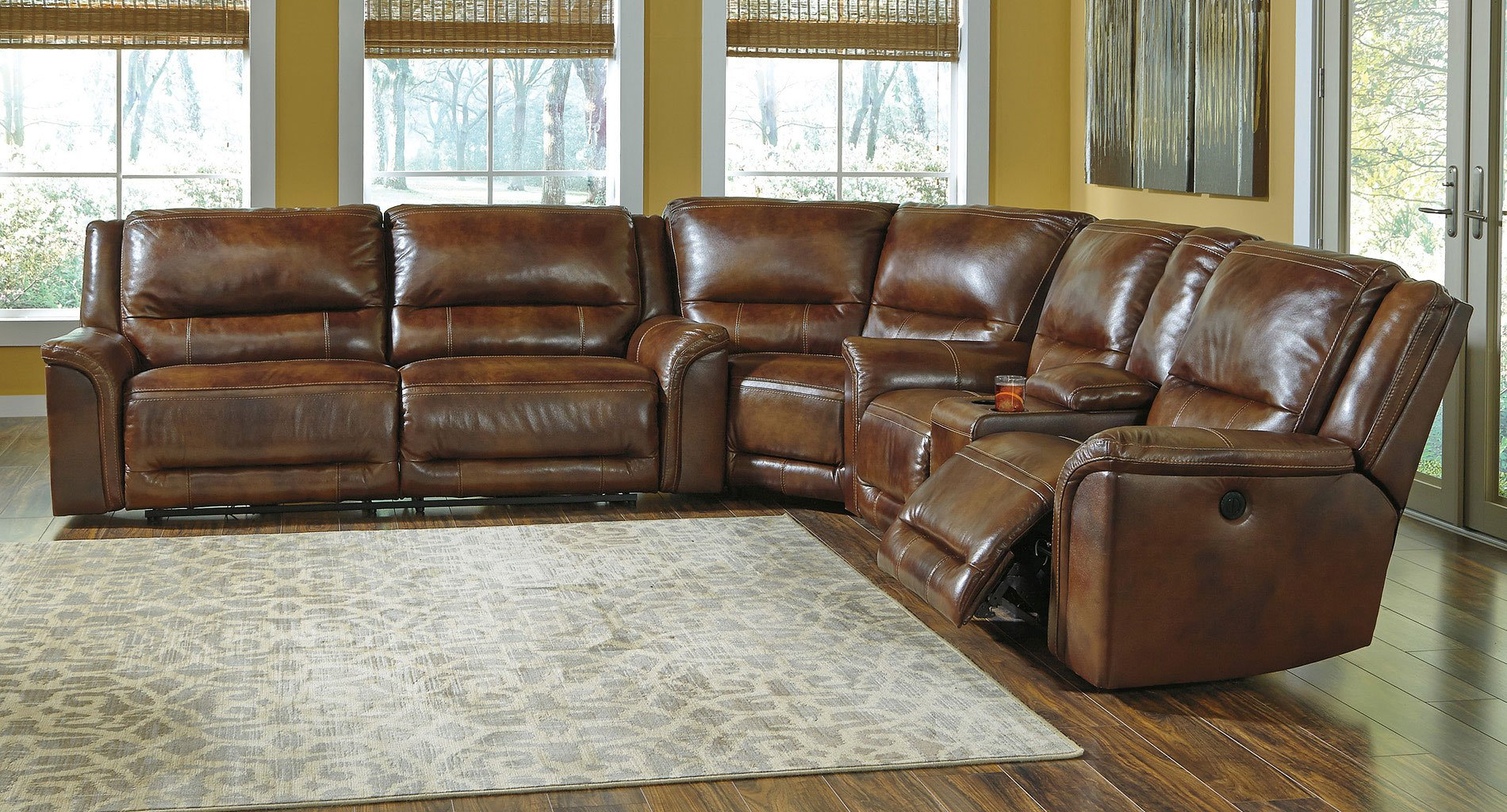 ashley electric reclining sofa parts made in italy singapore jayron leather sectional signature design