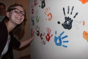 Leaving my hand print on Bernadett's wall.