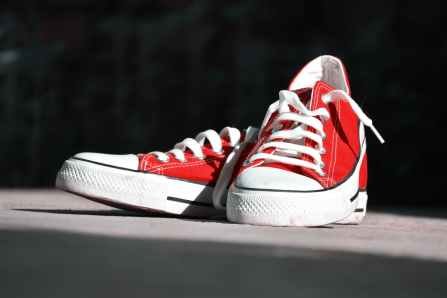 shallow focus photography of pair of red low top sneakers