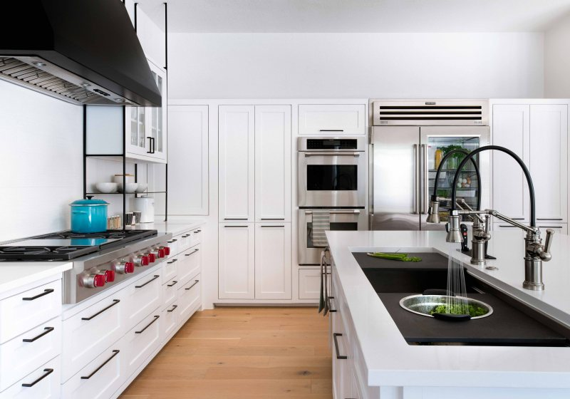 white kitchen with black metal shelving and Galley sink