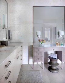 Custom organic master bath with Wood-Mode cabinetry and makeup vanity with sconces on mirror