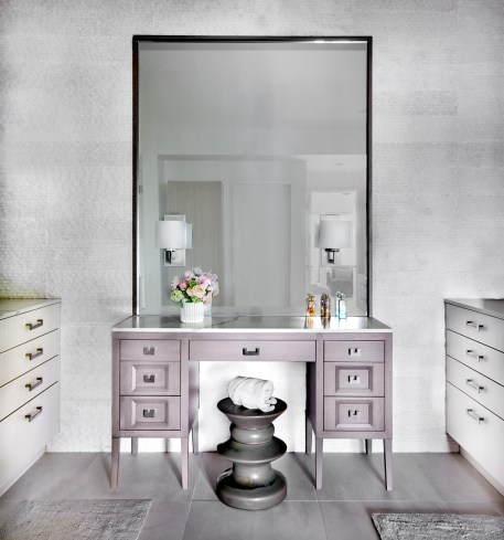 custom makeup vanity with Eames stool and sconces on large mirror