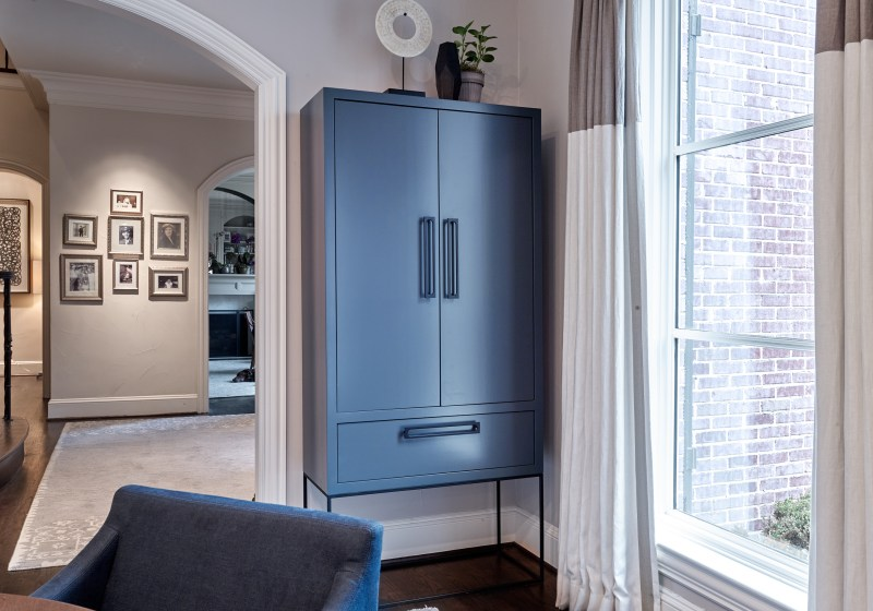navy blue cabinet with metal legs