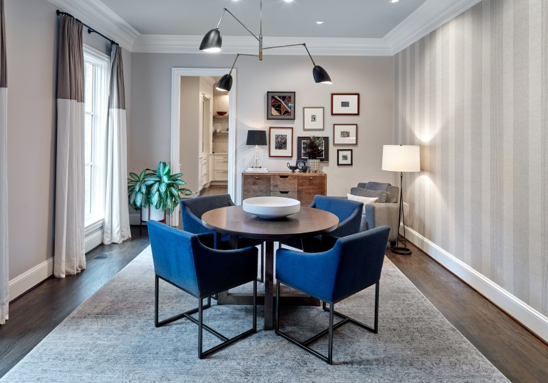 dining room with round table and navy blue chairs