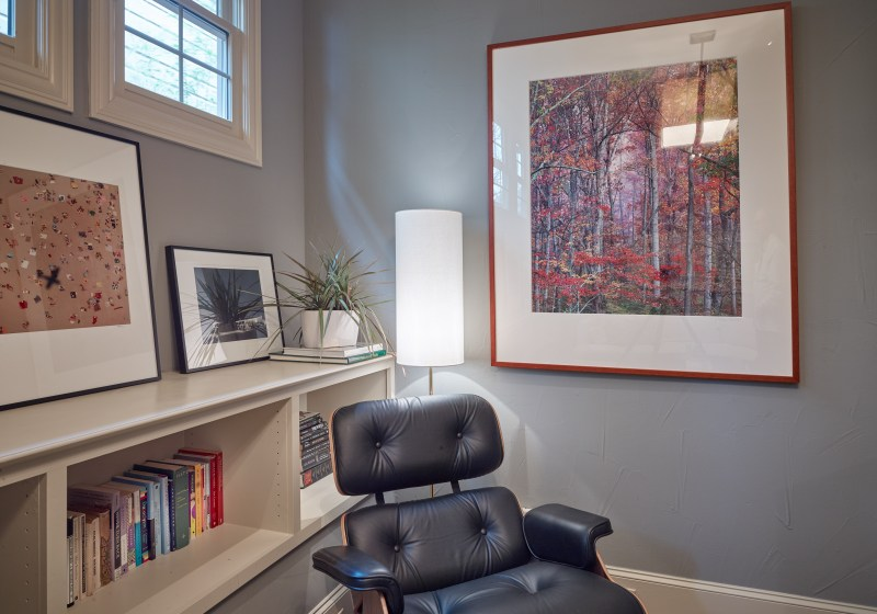 Eames lounge chair in family room in front of book case