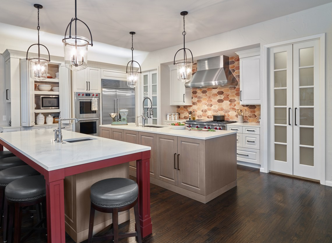 farmhouse kitchen with white and red cabinets and hexagon brick backsplash