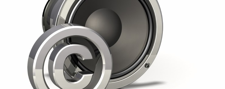 Copyright symbol in front of a speaker.