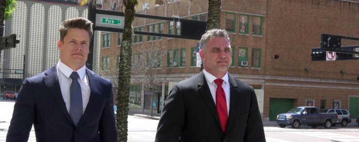 Andriy Lytvyn and Anton Hopen outside Tampa Federal Courthouse