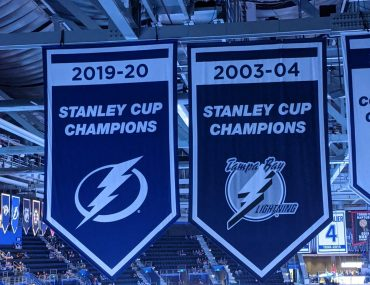 tampa bay lightning branding and stanley cup banners with different logos