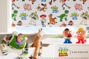 close up of toy story roller blind with buzz light year toy lay on window sill