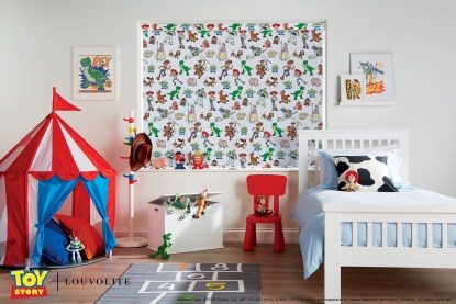 toy story roller blind with toy characters on window sill in a closed position