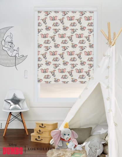 room setting of kids bedroom or playroom with dumbo disney fabric semi open on a white wall
