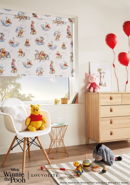 Disney winnie the pooh and friends roller blind roomsetting with teddies of pooh piglet and eeyore chillaxing in a childs bedroom