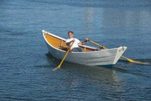 http://www.dreamstime.com/royalty-free-stock-image-man-rowing-boat-harbor-image28701236