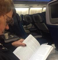Mum on the plane reading one of the many free books she picked up at RT