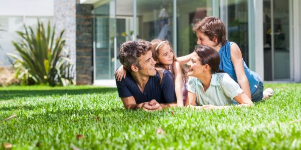 family spending time together on recently treated lawn