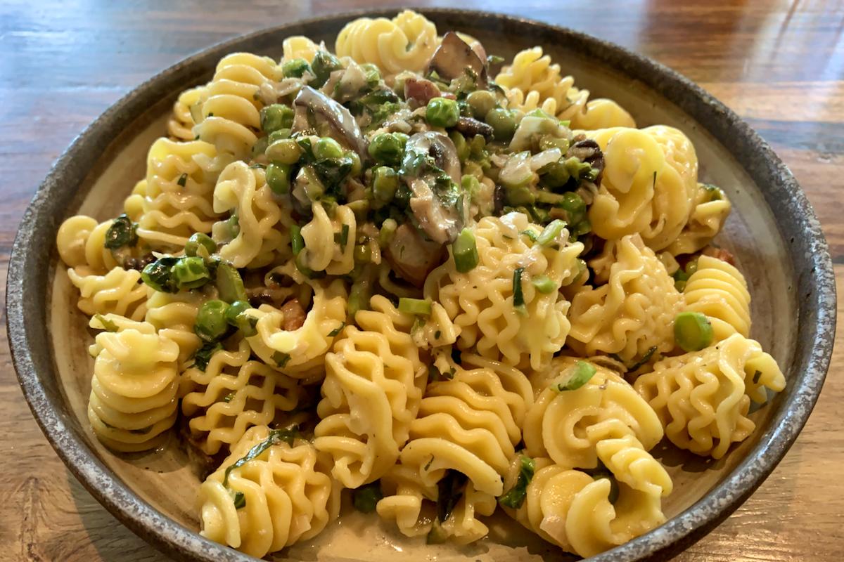 Radiatori pasta with a creamy mushroom, pea and parmesan sauce