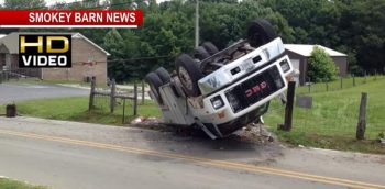VIDEO: Large Utility Truck Rollover In Adams