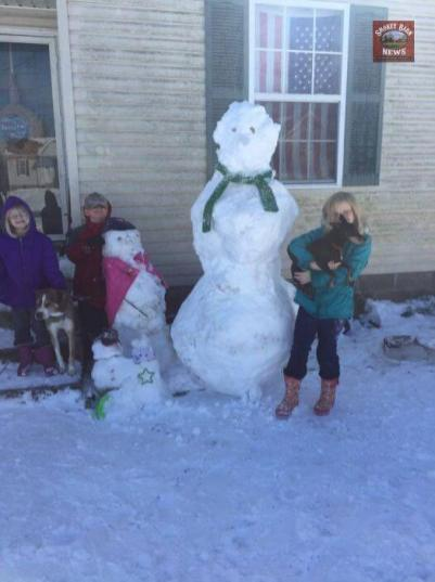 Submitted by Stephanie Hendley Stubblefield - We built our tallest snowmen to date! There's a total of 5. One is driving the green tractor. We love the snow!