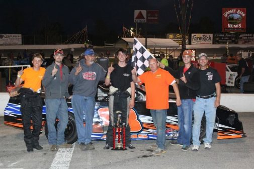 Tanner Arms and Crew in victory lane