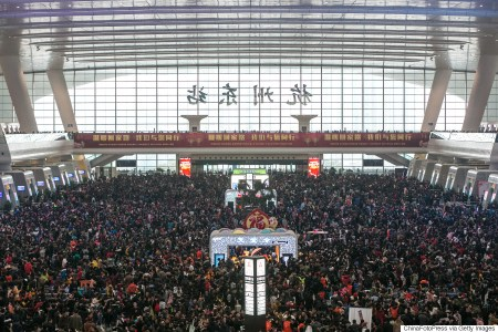 HANGZHOU, CHINA - FEBRUARY 01: (CHINA OUT) Passengers wait for trains at Hangzhou East Railway Station as they head back home for the upcoming Spring Festival on February 1, 2016 in Hangzhou, China. Chinese people are preparing for the Spring Festival, the Year of Monkey, which will fall on February 8 according to Chinese calendar. (Photo by ChinaFotoPress/ChinaFotoPress via Getty Images)