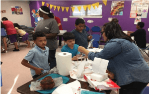Kids participate in science experiments at the KAD Korner Store