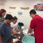 Texas State University brings science experiments to families at C.M. Allen Homes