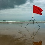 Red flag on beach.