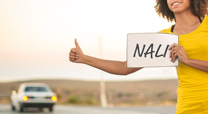 Hitch hiker with Nali sign
