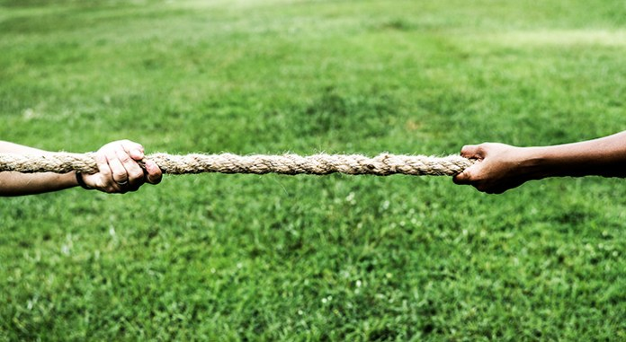 hands on rope in tug of war estate executor superannuation